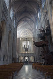 Leuven - Nave of st. Peters gothic cathedral and rays of morning sun Royalty Free Stock Photos