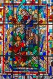 Leuven - St. Damien de Vesper inter his leprous windowpane of st. Anthony church. On September 3, 2013 in Leuven, Belgium Royalty Free Stock Photos