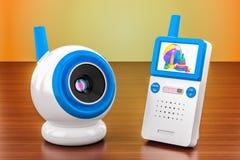 Leva del bebé y monitor audio del bebé en la tabla de madera renderin 3D Imágenes de archivo libres de regalías