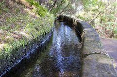Levada das 25 fontes, irrigation canal detail view, touristic hiking trail, Rabacal, Madeira island. Portugal Stock Photography