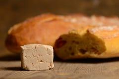 Levadura y pan en la madera Foto de archivo