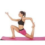 Levantamento bonito novo da ioga da menina Fotos de Stock
