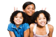 Levantamento de três amigos Fotografia de Stock Royalty Free