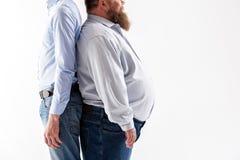 Levantamento magro e gordo dos indivíduos foto de stock royalty free