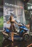 Levantamento modelo em EICMA 2014 em Milão, Itália Imagens de Stock