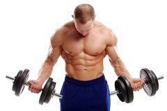 Levantamiento de pesas. Hombre fuerte con una pesa de gimnasia Imagen de archivo