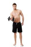 Levantamiento de pesas muscular del hombre de los deportes Foto de archivo libre de regalías