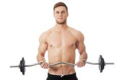 Levantamiento de pesas muscular del hombre de los deportes Fotografía de archivo libre de regalías