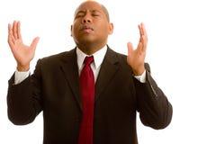 Levantando as mãos na oração Fotos de Stock Royalty Free