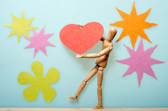 Levantando um coração de papel Foto de Stock