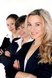 Levarsi in piedi delle tre donne di affari Fotografia Stock Libera da Diritti