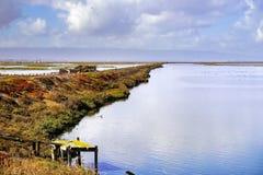 Levee in Alviso marsh after a rainy day, south San Francisco bay, San Jose, California royalty free stock image