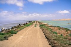 Levee on the shoreline of east San Francisco bay, Fremont, California. Blue sky and white clouds in the background stock images