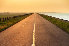 Levee sunset. Beautiful spring sunset at the levee with a road to nowhere royalty free stock image