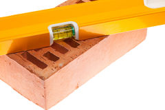 Level and a brick Stock Images