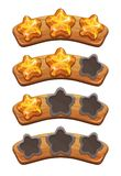Level complete ranking banners with crystal stars. On the wooden board Royalty Free Stock Photo