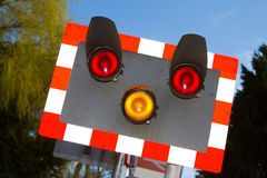 Level crossing. Warning on a white background Royalty Free Stock Photo