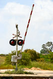 Level crossing. An open level crossing gate in countryside Royalty Free Stock Photo