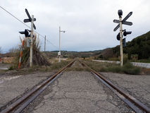 Level crossing road and rail, symmetrical Stock Photography
