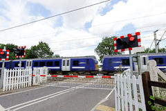 Level Crossing with Train Royalty Free Stock Photos