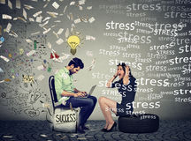 Level of education and employee compensation. Stressed woman sitting next to a successful man under money rain working on computer Royalty Free Stock Images