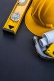Level helmet blueprints hammer tape measure Stock Photos