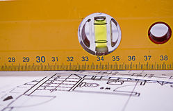 Level meter. Tool over plans Royalty Free Stock Photos