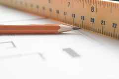 Level and pen on architects plan Royalty Free Stock Photography