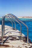 Level row Metallic chrome-plated Handrails, railings on a yacht. Against the background of a sunny bright sky royalty free stock photo