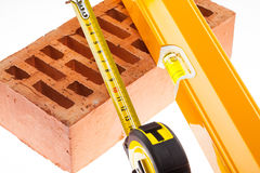 Level, tap line and brick Stock Images