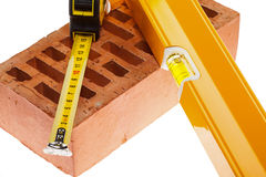 Level tape line and a brick Stock Images