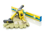 Level, tapeline, hammer and gloves Stock Images