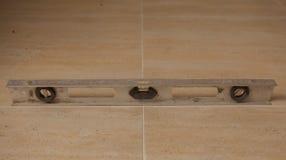 Level on the tile, tile set to void.  Stock Photos