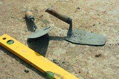 Level and trowel Stock Photos