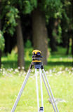 Leveler - a device for detecting the marks on the ground, the calculation of longitudinal and transverse slope, to make the constr Royalty Free Stock Photo