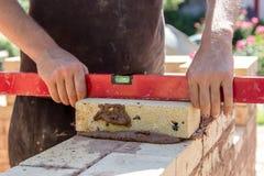 Leveling a brick Royalty Free Stock Image