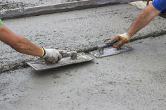 Leveling concrete with trowels Royalty Free Stock Photos