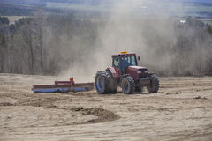 Leveling the fields. Farmer leveling the fields on a bright sunny afternoon Stock Photography
