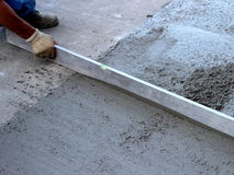 Leveling fresh concrete Royalty Free Stock Photo