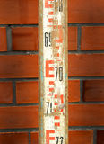 Leveling rod vintage. Wooden metering Royalty Free Stock Photo