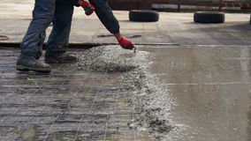 Leveling Wet Concrete Surface with a Metal Screed Board stock video footage