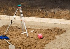 Levelling equipment on working site. Equipment for level measurement when building a house Stock Photos