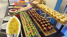Levels of colorful desserts display stock photo