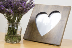 Levender plant with picture frame. Heart picture frame with Lavender plant on the side royalty free stock photos