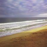 Lever de soleil à la plage de bord de la mer Photographie stock libre de droits