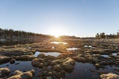 Lever de soleil alpin de marais Photos stock