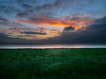 Lever de soleil au-dessus de l'estuaire de Humber, Angleterre est Images stock