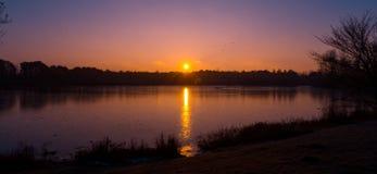 Lever de soleil au-dessus de lac denmark Photos stock