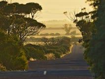 Lever de soleil au-dessus de route Photos libres de droits
