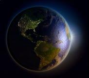 Lever de soleil au-dessus des Amériques de l'espace Photo stock